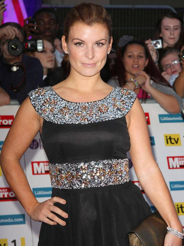 Coleen Rooney was asked for £5,000 for the photos' return, a court heard