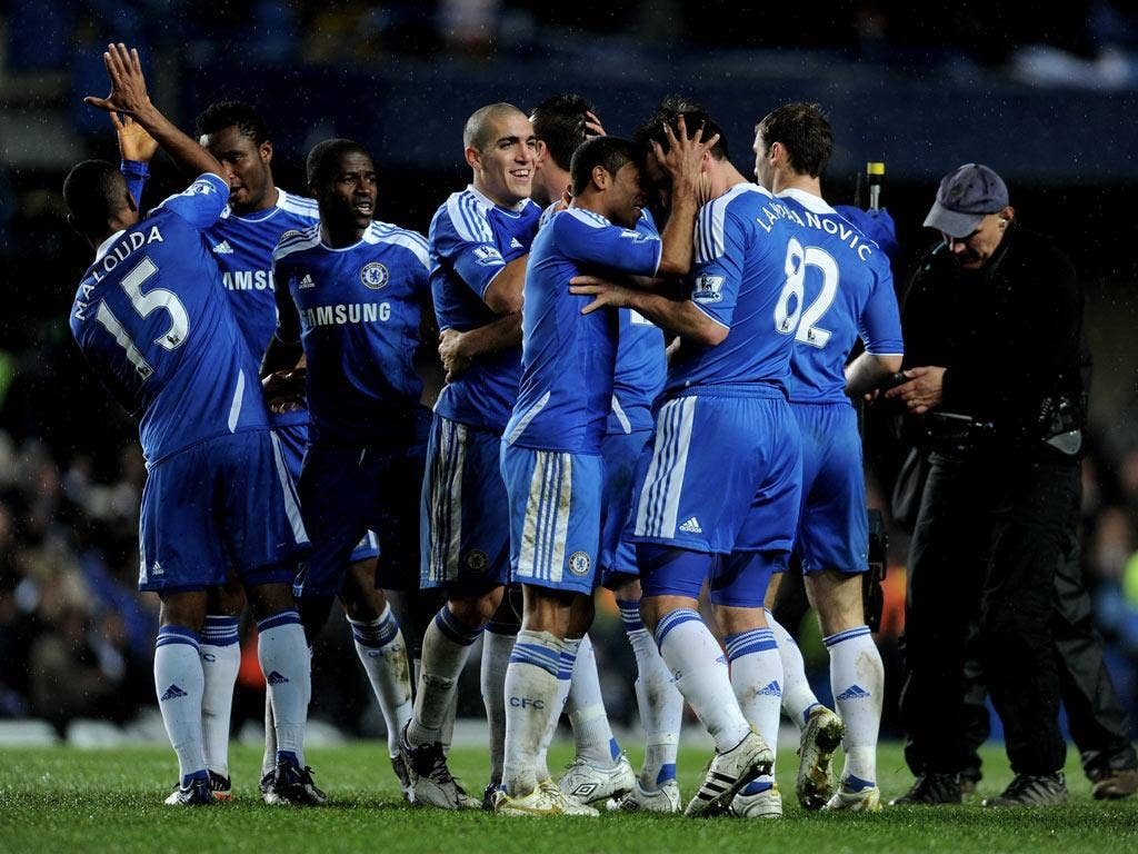 Ashley Cole celebrates the winning goal against City with Frank Lampard