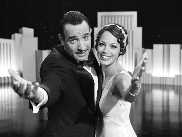 Jean Dujardin portrays George Valentin, left, and Berenice Bejo portrays Peppy Miller in a scene from The Artist