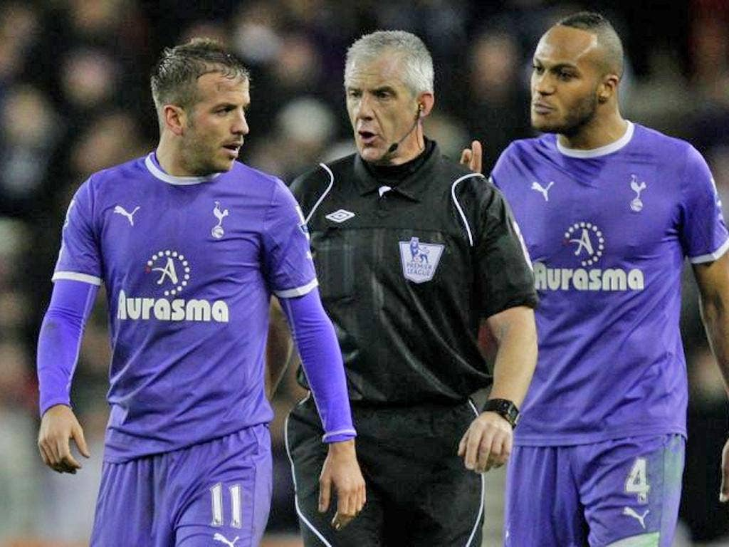 Spurs' Rafael van der Vaart and Younes Kaboul who was shown two yellows at Stoke by referee Chris Foy
