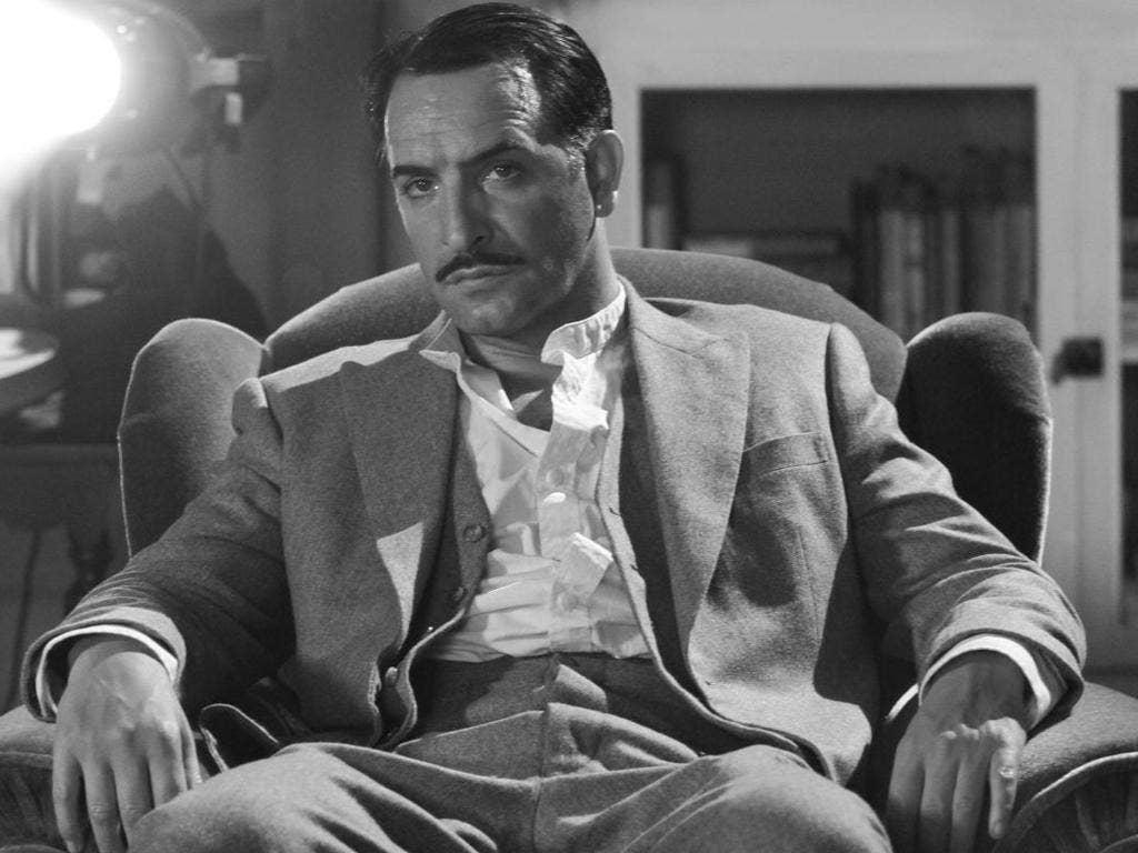 Jean Dujardin portrays George Valentin in The Artist