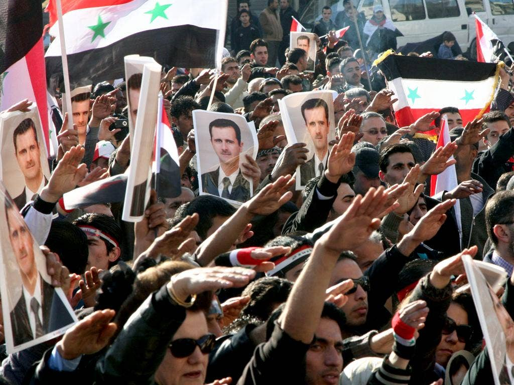 Assad supporters hold a counter-rally in Damascus yesterday
