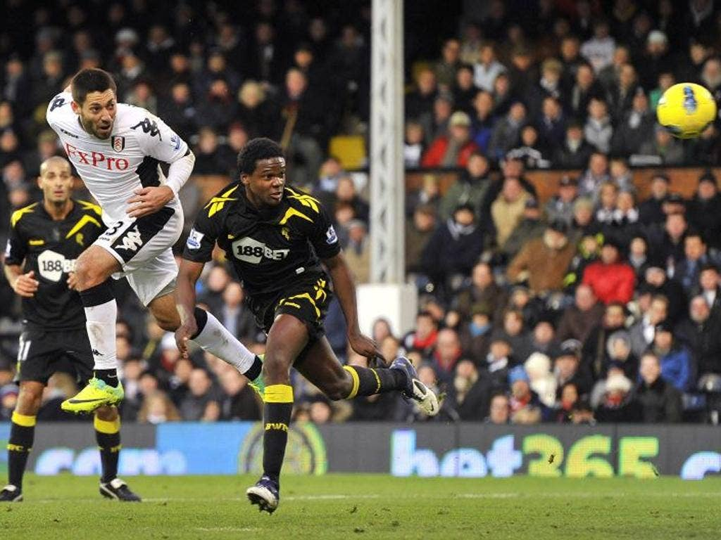 Head master: Clint Dempsey nods home Fulham's opening goal