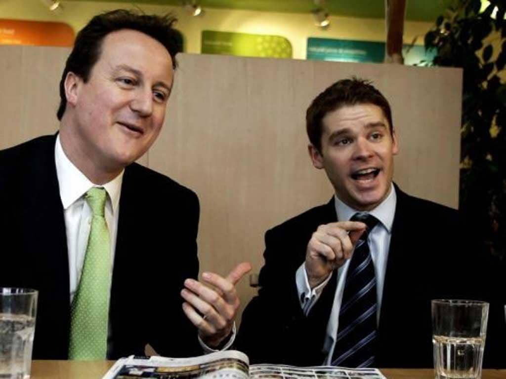 A photo from March 2006 of David Cameron with Conservative MP Aidan Burley, who has been sacked as a Commons aide for 'offensive' behaviour