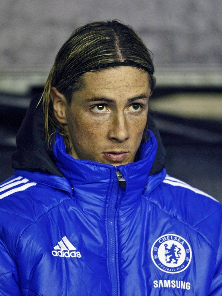 Poor old Fernando Torres is forced to warm the bench yet again at Wigan