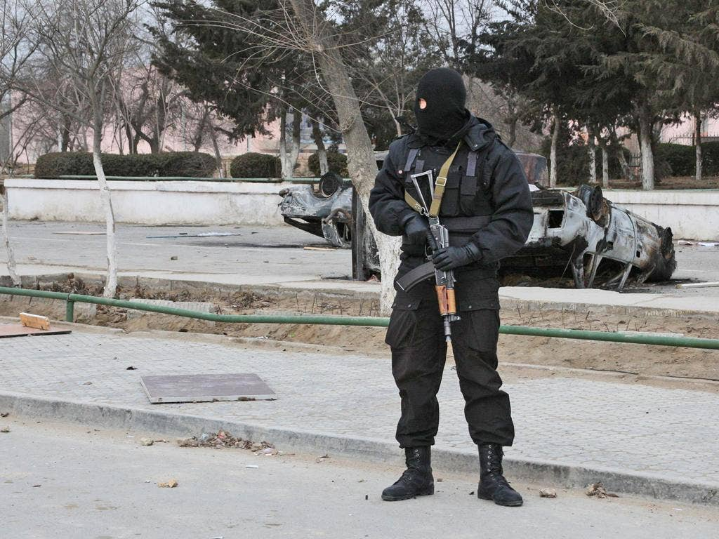 A riot police officer on patrol in Zhanaozen after violent clashes over the weekend