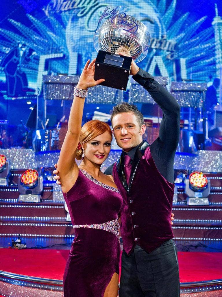 Aliona Vilani and Harry Judd celebrate with the winning trophy on Strictly Come Dancing,after their performances impressed viewers