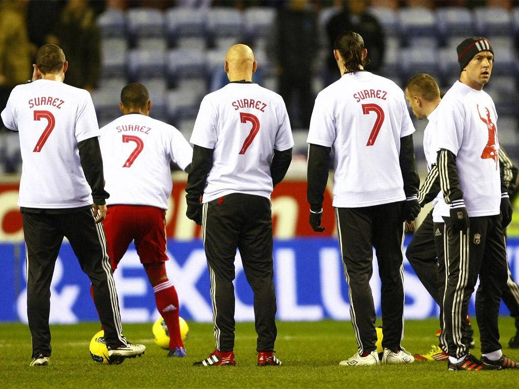 Liverpool players display their support for Luis Suarez