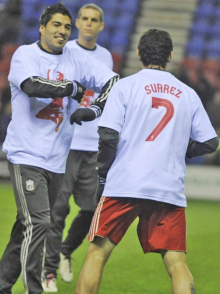 Luis Suarez is all smiles in the warm-up as his team-mates wear T-shirts supporting the Liverpool forward