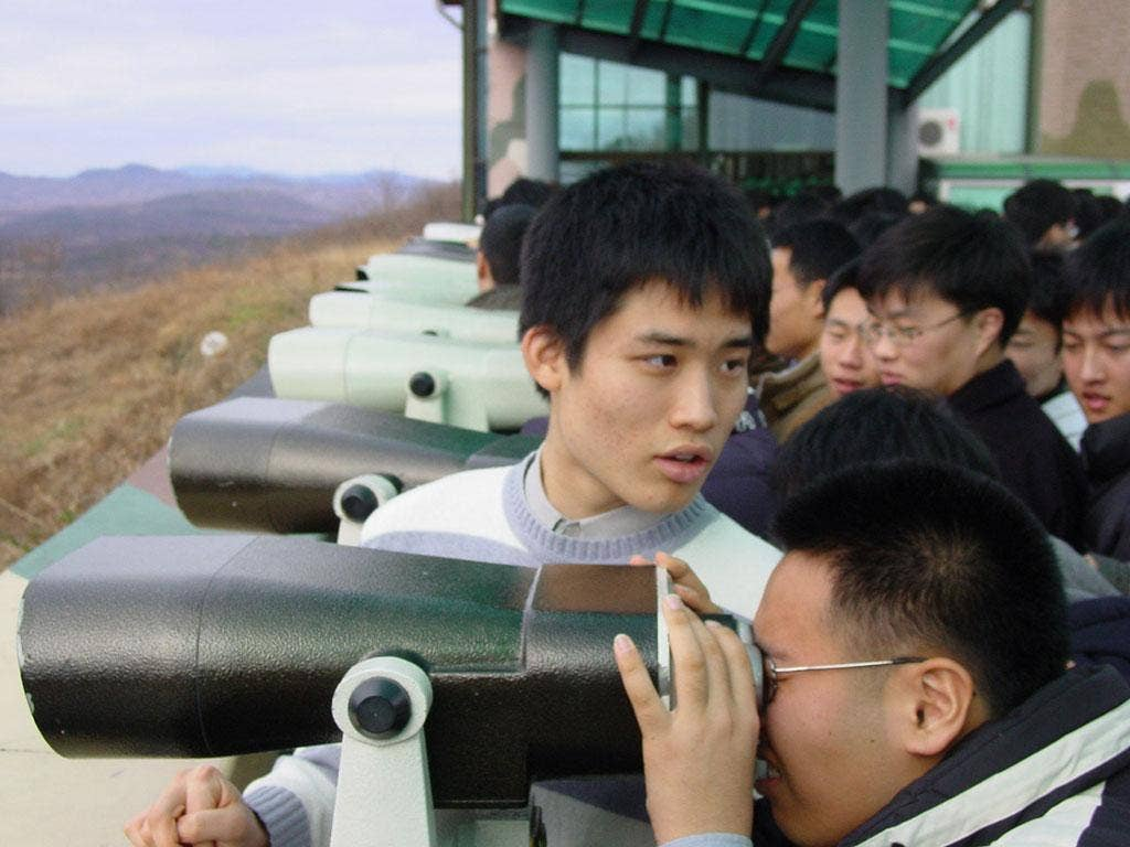 Looking ahead: Tourists on the south side of Korea's De-Militarized Zone