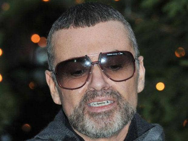 George Michael has returned home to the UK after leaving hospital in Vienna