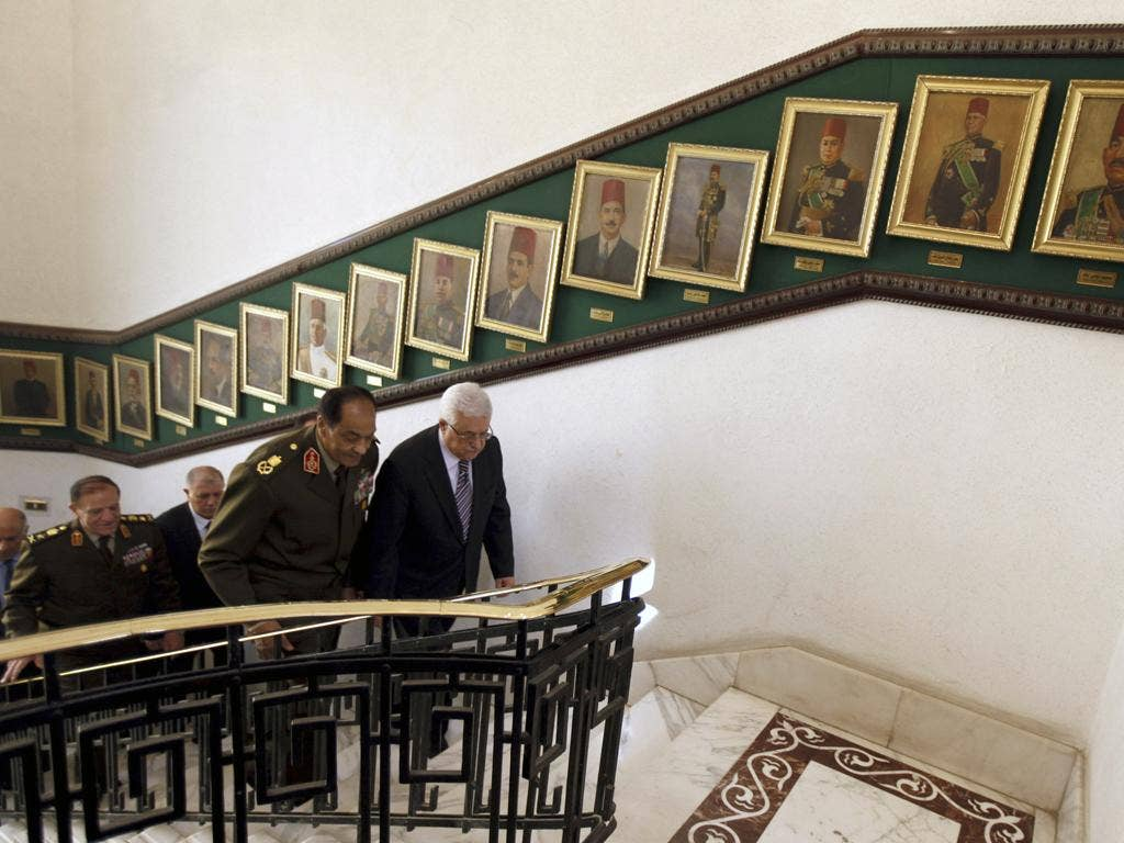 Field Marshal Hussein Tantawi, the head of Egypt's armed forces, with the Palestinian President Mahmoud Abbas, centre,in Cairo