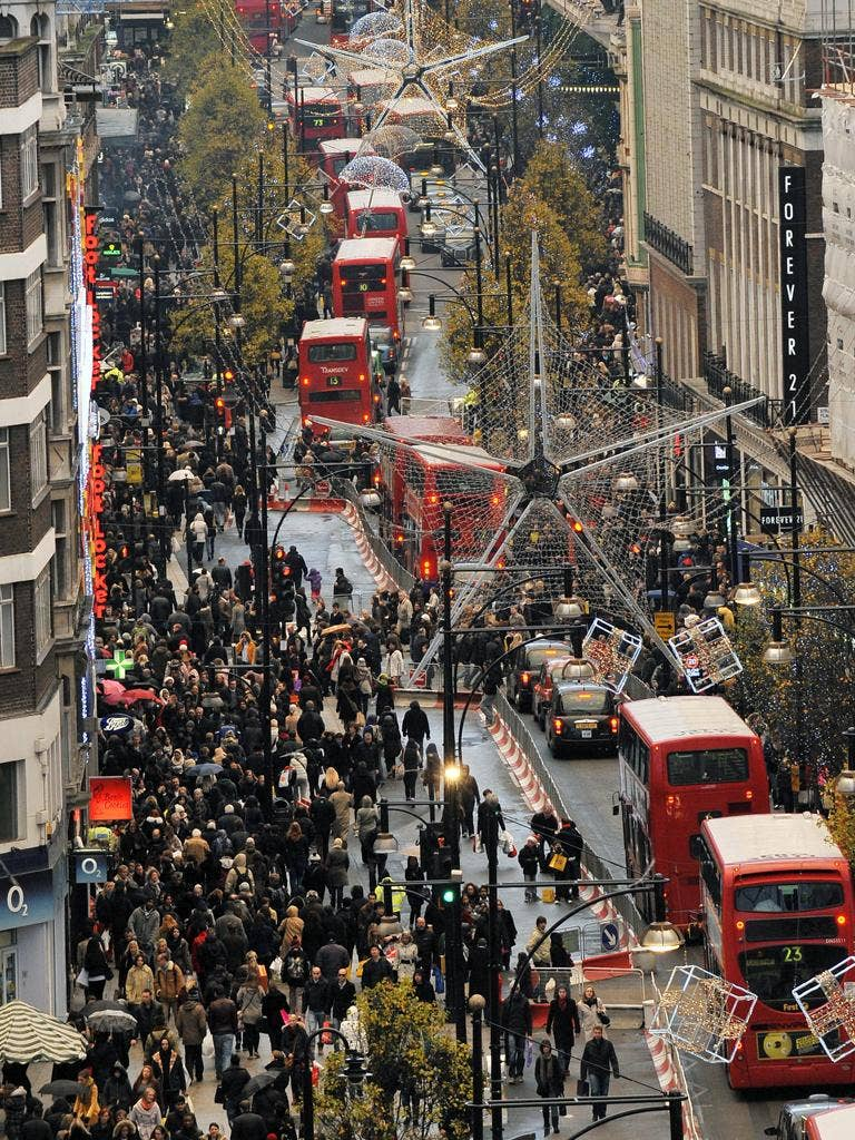 Shoppers throng Oxford Street in London yesterday