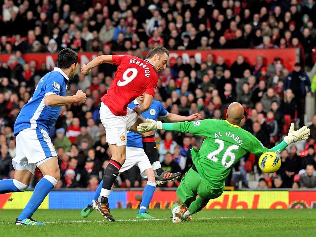 Dimitar Berbatov scores his second goal against Wigan Athletic