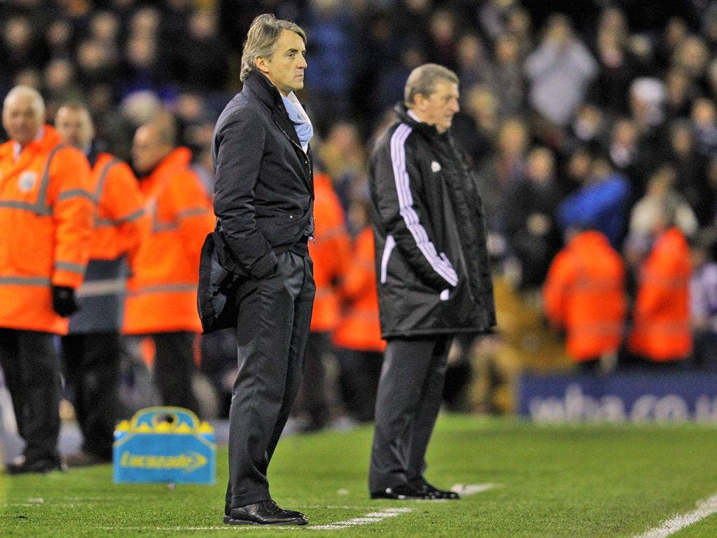 Roy Hodgson and Roberto Mancini look on during the Barclays Premier League match between West Bromwich Albion and Manchester City