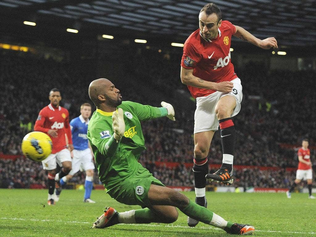 Manchester United's hat-trick hero Dimitar Berbatov scores against Wigan