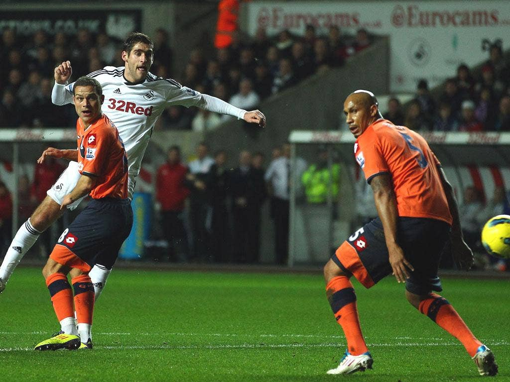 Danny Graham of Swansea scores the opening goal during the Barclays Premier League match