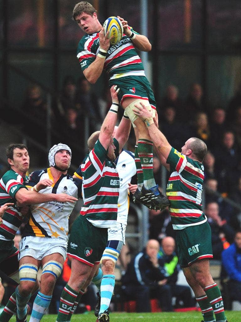 Ed Slater leaps high to win a line-out for Leicester at Sixways
