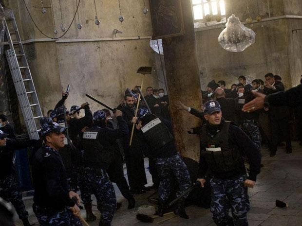 A Christmas cleaning of the Church of the Nativity turned into scuffles today