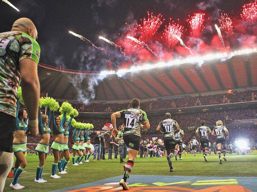 Fireworks and cheerleaders greet the players onto the Twickenham pitch