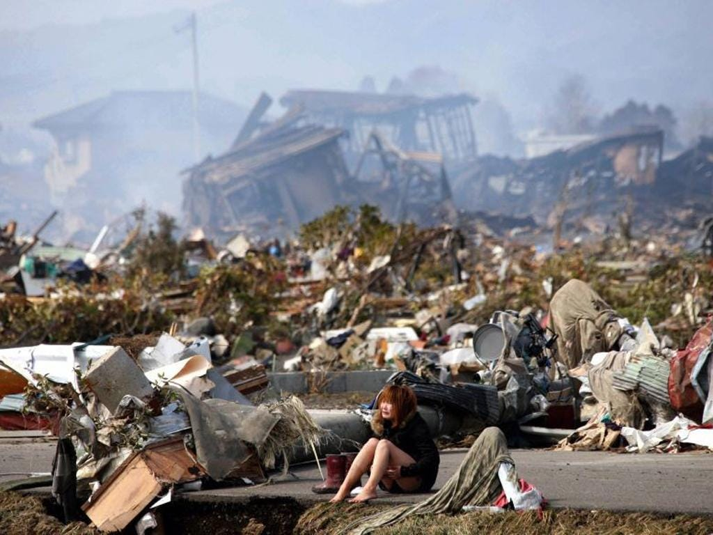 <p><strong>After the Tsunami, Japan<br/></strong><em>13 March</em></p> <p>A woman sits and weeps amid the remains of the city of Natori in northern Japan, after a massive earthquake and tsunami that killed around 15,000 people, as well as causing catastro