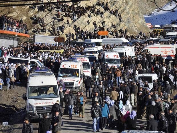 People gather near a hospital morgue yesterday after bodies of victims killed in the air strikes arrived in the Turkish town of Uludere