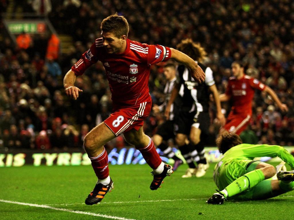 Steven Gerrard celebrates after putting the ball through Tim Krul's legs for Liverpool's third goal
