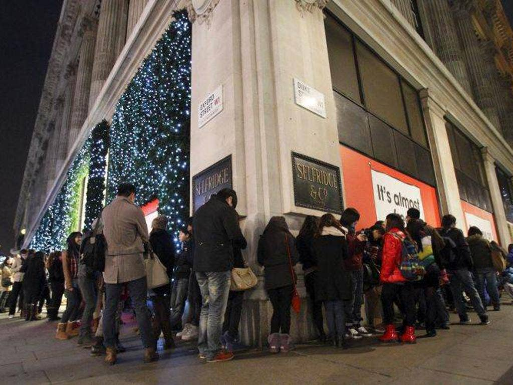 Bargain-hunters wait for Selfridges' sale to open on Boxing Day