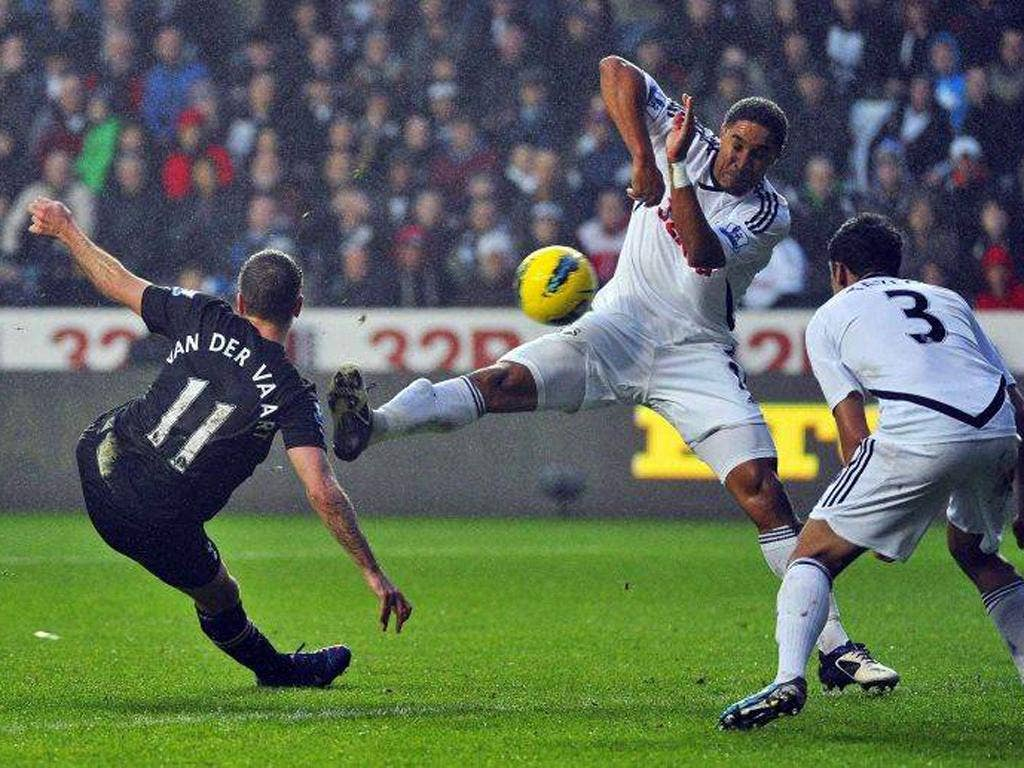Rafael Van der Vaart scores for Spurs despite the attentions of Ashley Williams and Neil Taylor