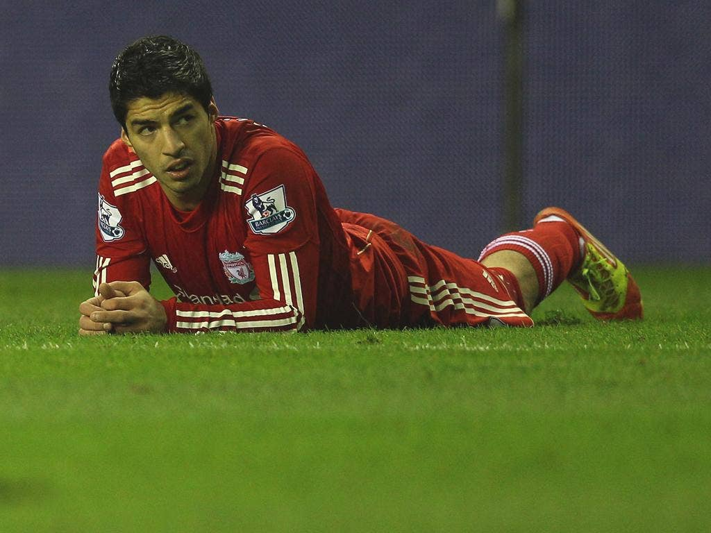 Luis Suarez is free to play against Manchester City tonight