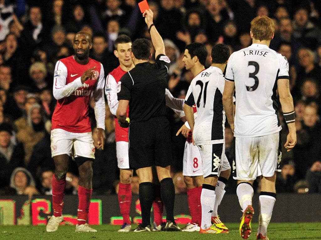 Johan Djourou was shown a second yellow for pulling back Zamora