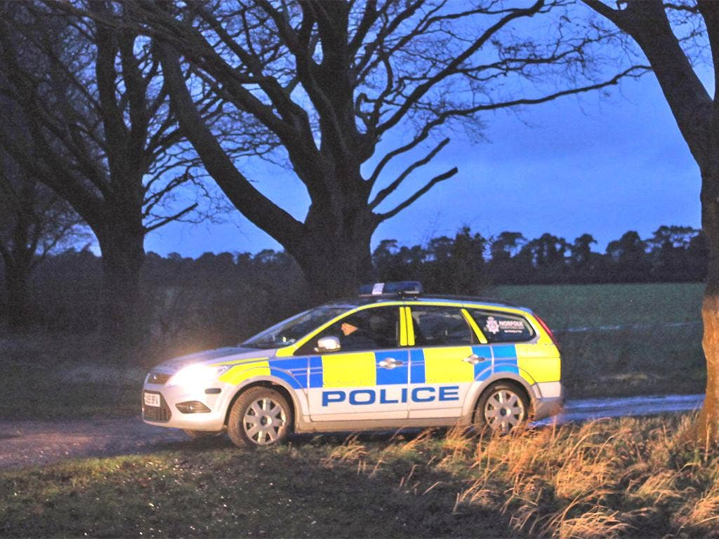 Police guarding the entrance to the woods on the Sandringham Estate where the remains were found