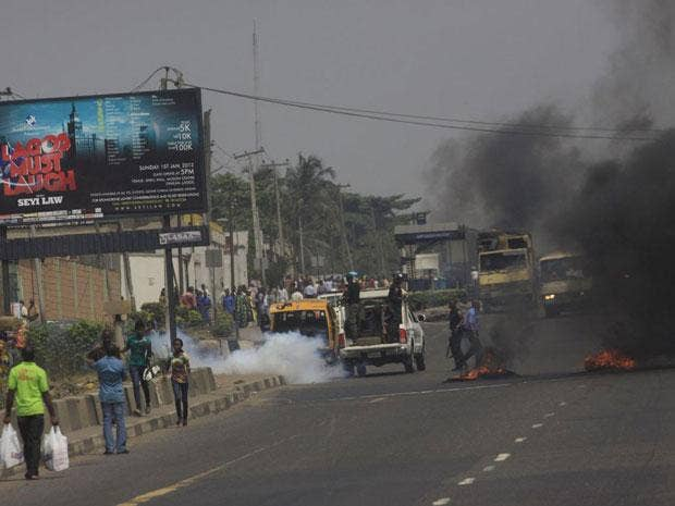 Angry protesters lit bonfires and vandalised at least three petrol stations in Lagos