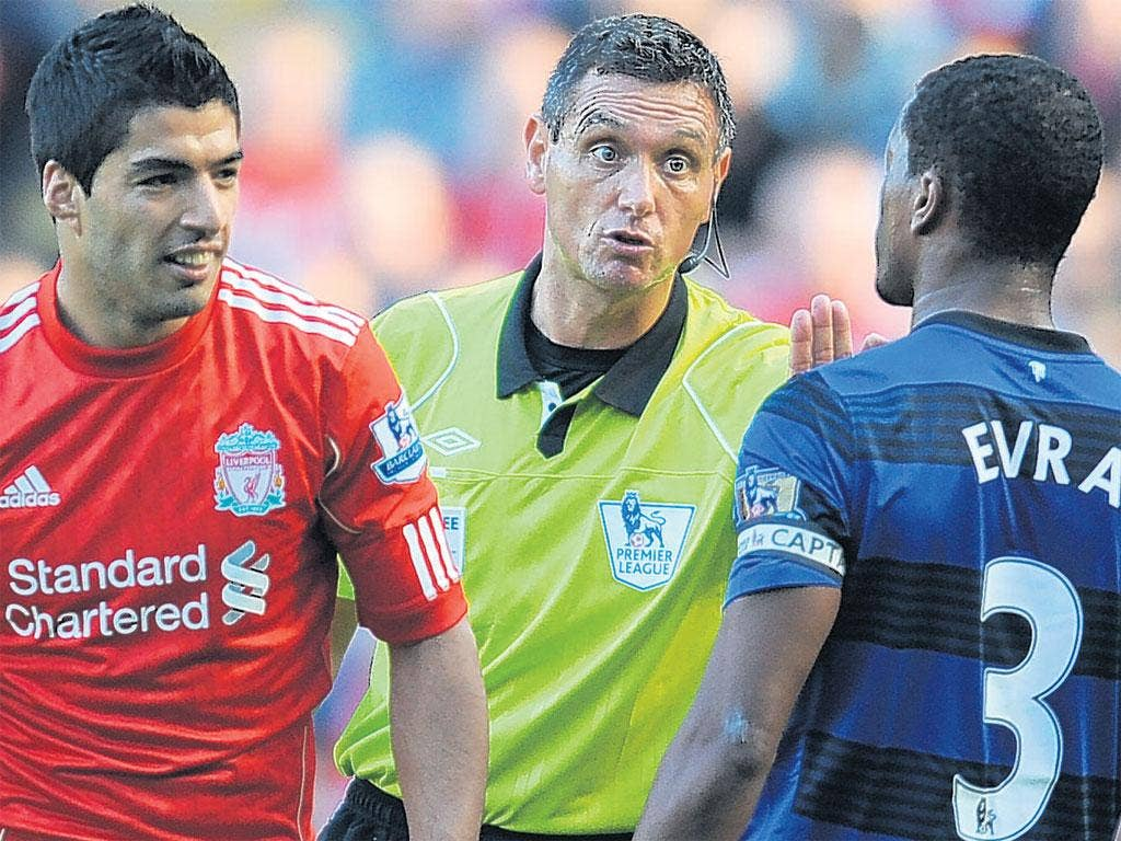 15 October 2011: Luis Suarez clashes with Patrice Evra and allegedly racially abuses him