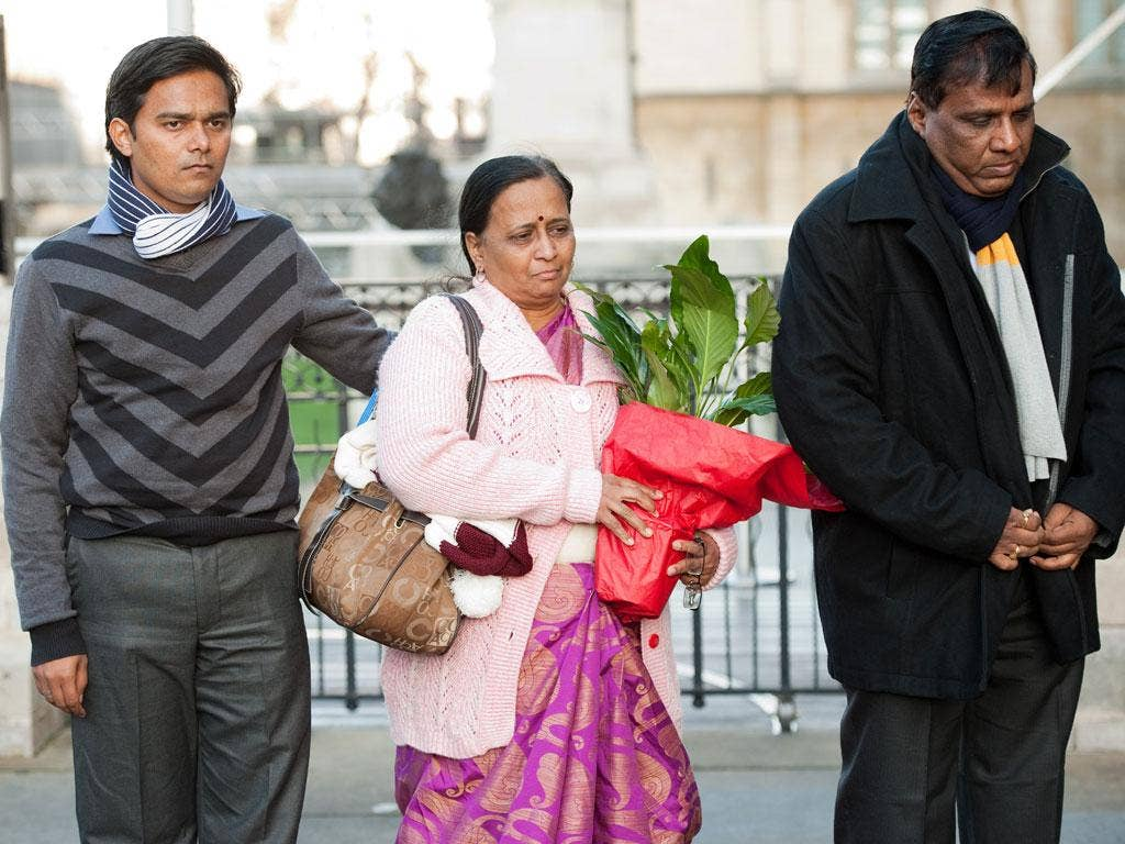 The mother of student Anuj Bidve, Yogini Bidve (centre), arrives at Parliament flanked by father Subhash Bidve (right) and brother-in-law Rakesh Sonawane