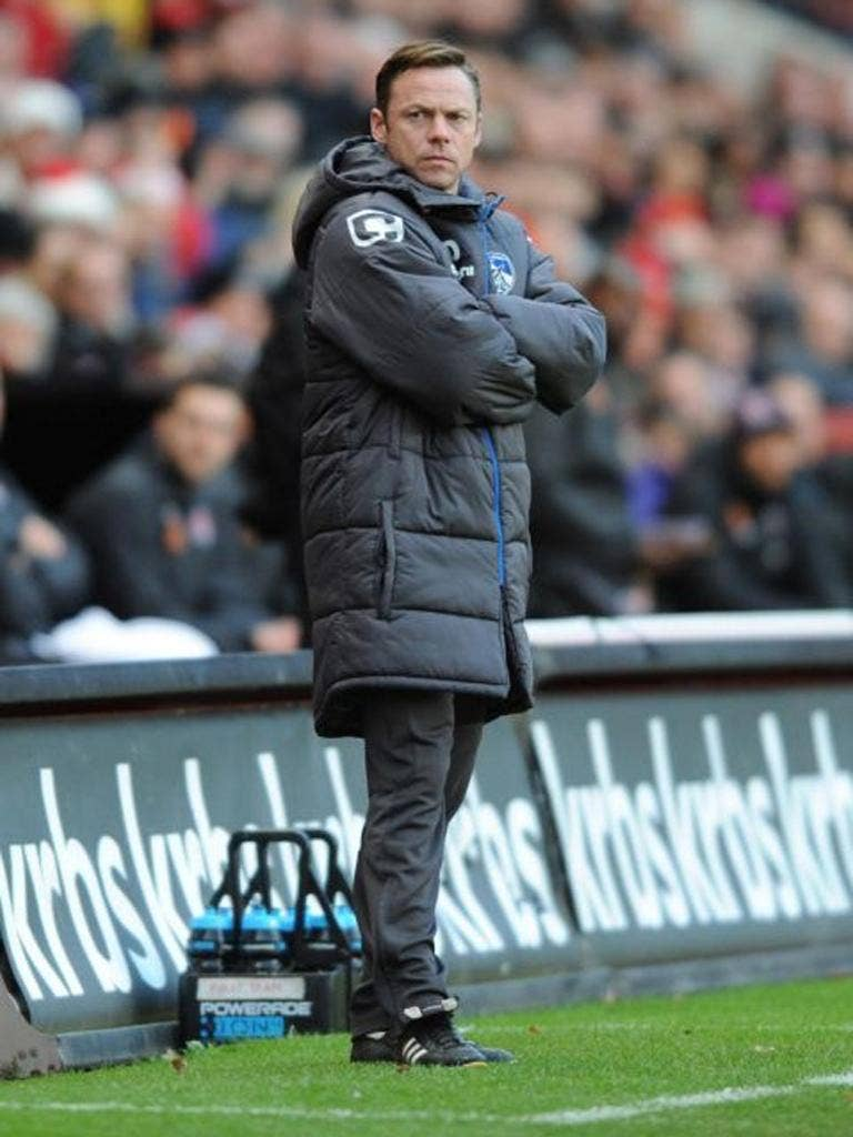 Oldham Athletic manager Paul Dickov deep in thought during the League One match at The Valley