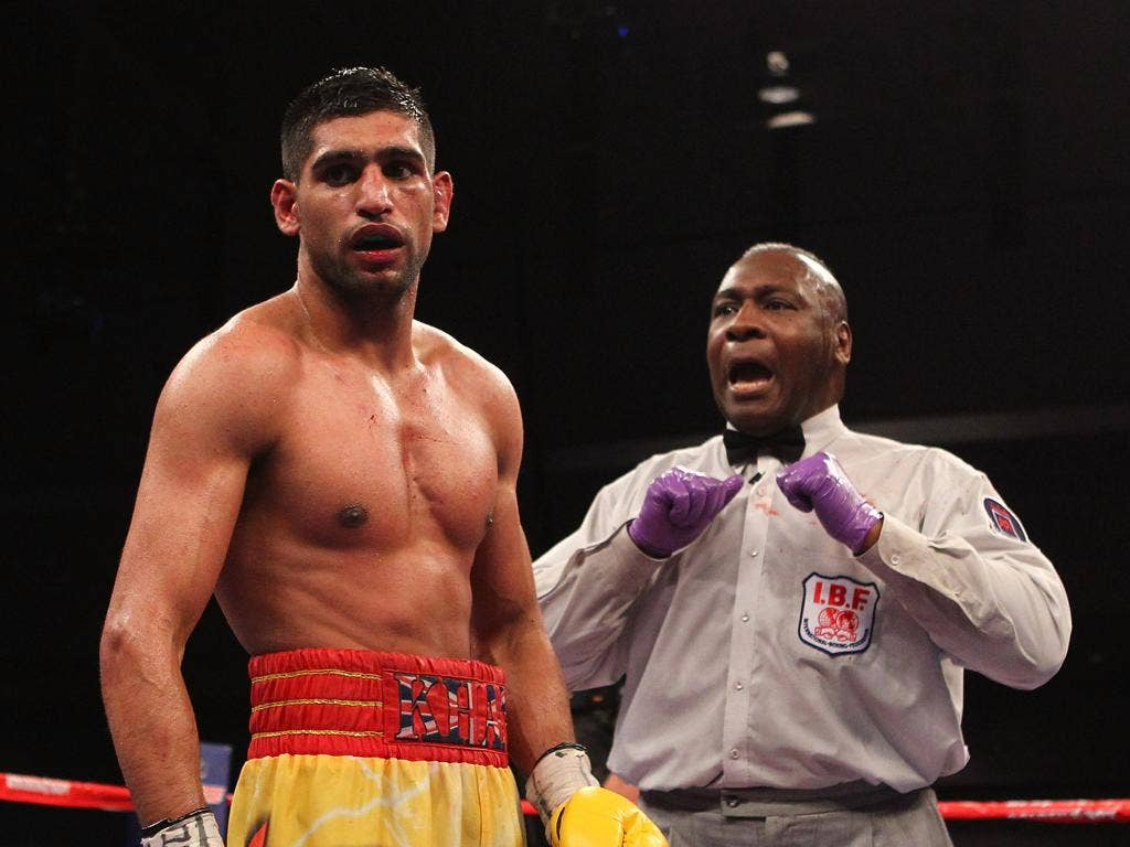It seems that a mistake was made in the marking of round seven, in which Khan had a point deducted for pushing
