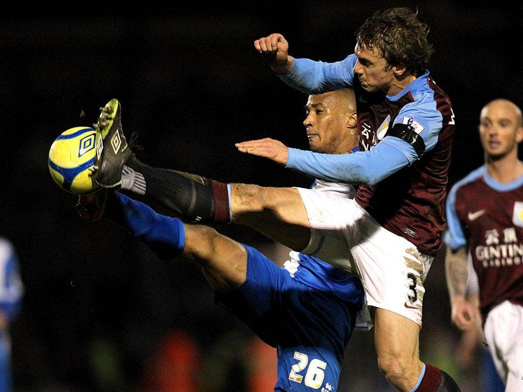 Aston Villa's Stephen Warnock (right) and Bristol Rovers' Chris Zebroski battle for the ball during a routine win for the Villans