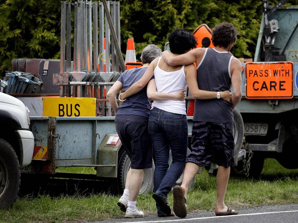 Relatives grieve near the crash site