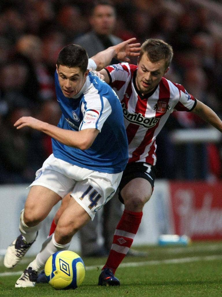 Sunderland's Sebastian Larsson pursues Peterborough's Tommy Rowe yesterday