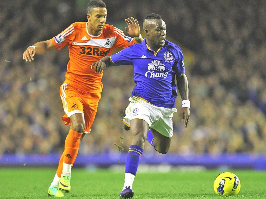 Everton's Royston Drenthe, pictured tussling with Swansea's Scott Sinclair, has been one of David Moyes's low-budget signings