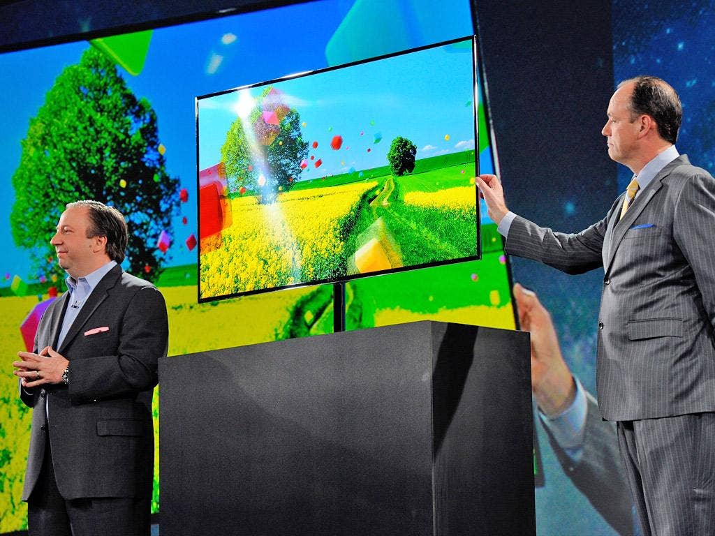 Remote leader: Samsung executives launch their new OLED TV at CES on Monday. But will it stand up to competition from Apple?