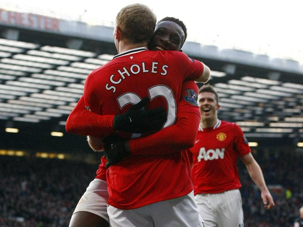 Danny Welbeck and Michael Carrick are all smiles after Paul Scholes scored for Manchester United against Bolton Wanderers yesterday