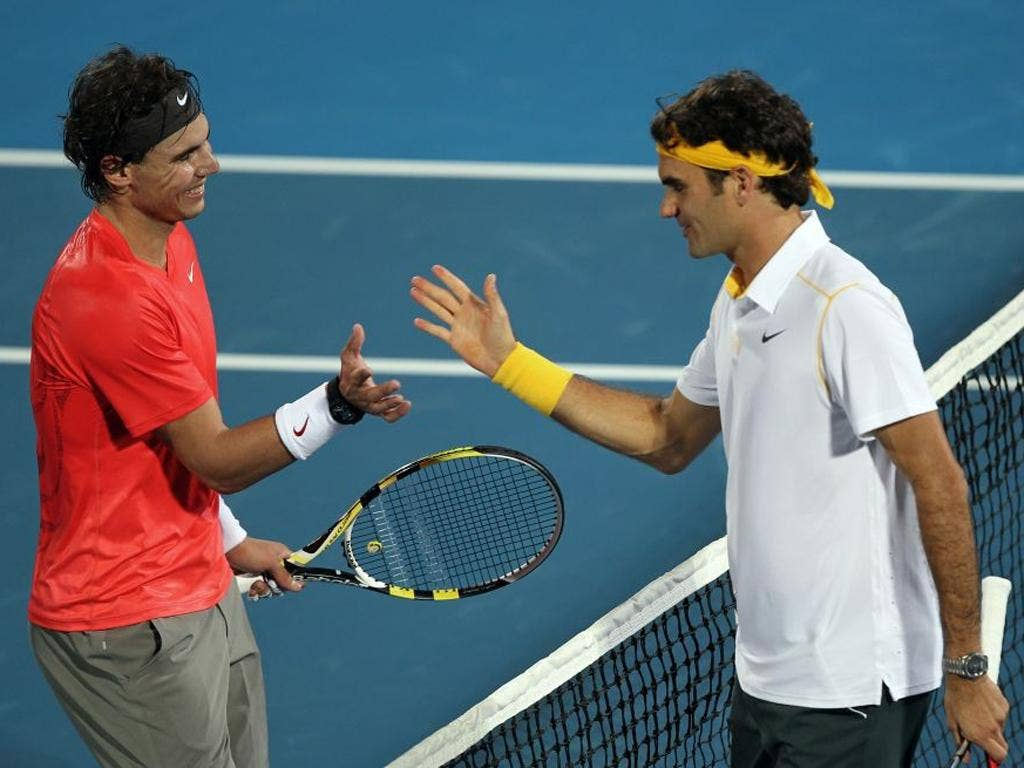 Rafael Nadal (left) and Roger Federer have had a rare disagreement over possible action about conditions on the tour