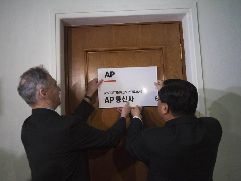 AP President Tom Curley, left, opens the new Pyongyang bureau