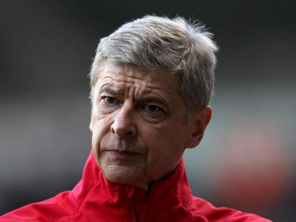 Arsenal Manager Arsene Wenger who is being compared to Victor Meldrew after he was caught by TV seething during the game against Swansea