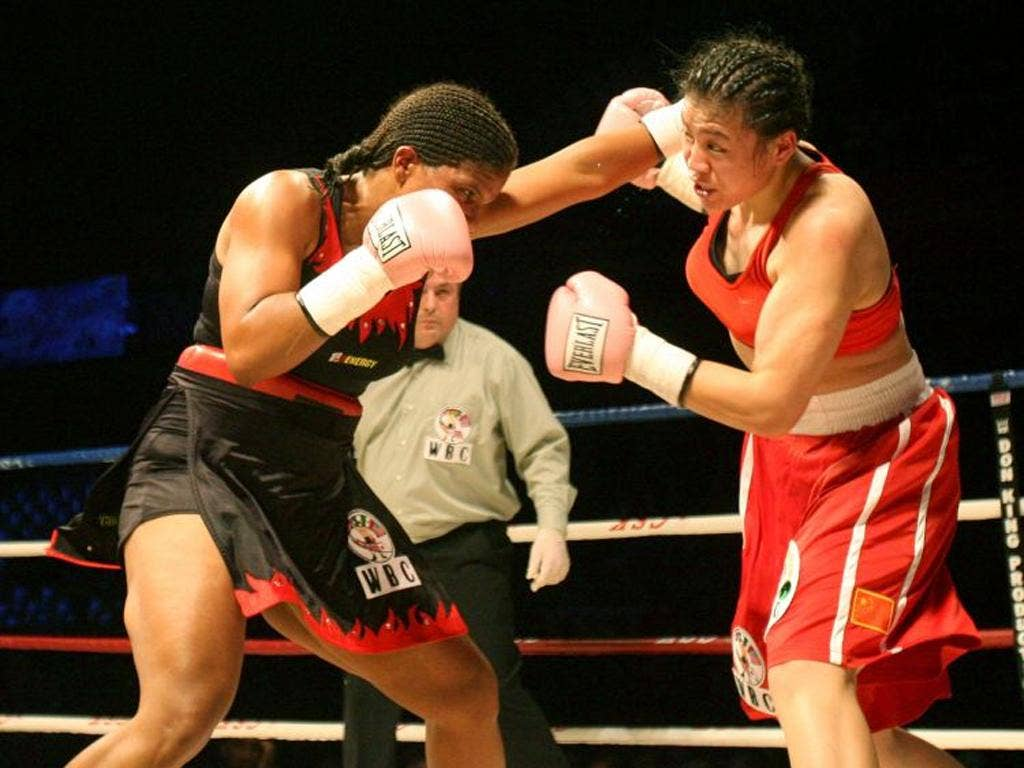 Boxing authorities will have to decide whether women boxers should wear skirts, as in the South African bout above, or shorts at the Olympics