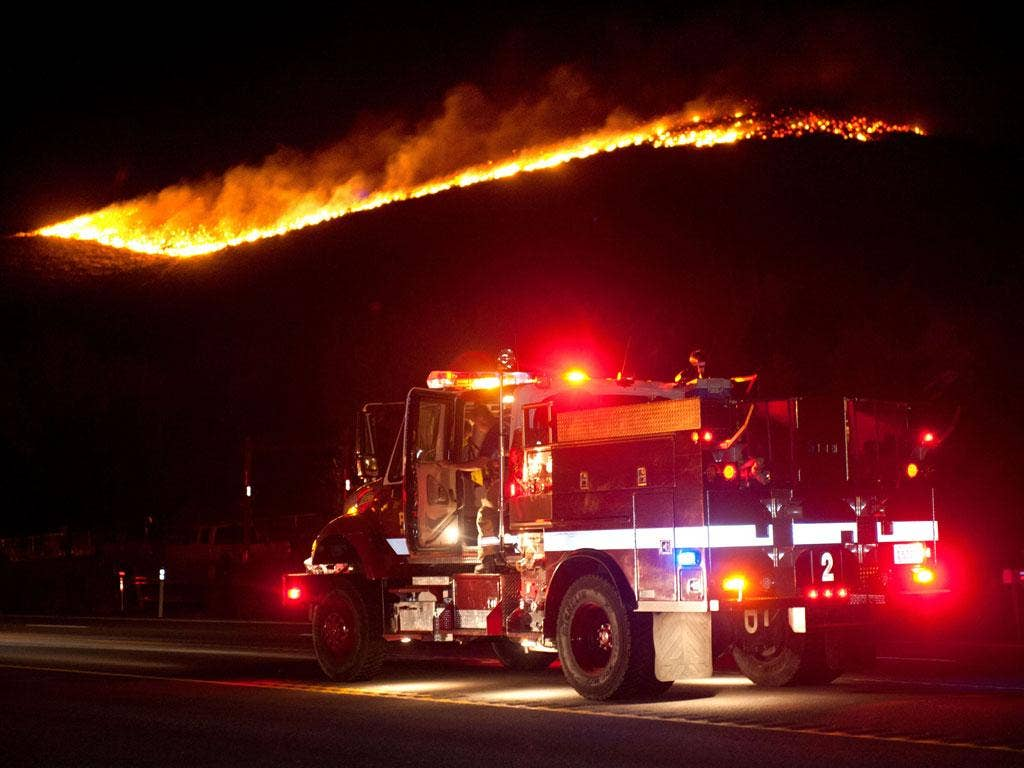 More than 20 homes have been destroyed by a fast-moving brush fire near Reno
