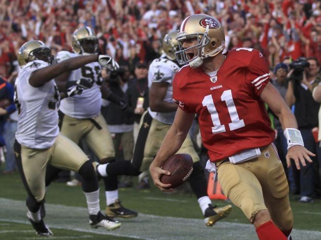 Joy for San Francisco's Alex Smith as he scores a fourth-quarter touchdown against New Orleans Saints