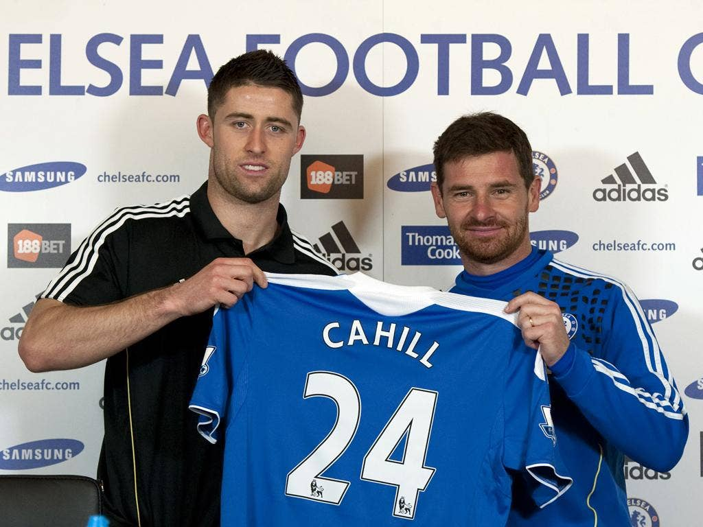 Gary Cahill (left) with Andre Villas-Boas at Cobham yesterday